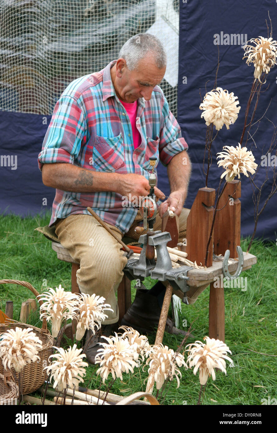 Woodworker /Craftworker Carving Flowers at Chatsworth Country Fair Derbyshire.England Stock Photo