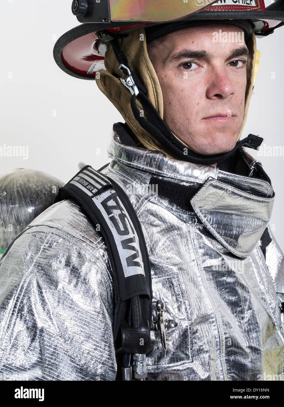 Male firefighter in high temperature aviation fuel   firefighting uniform with breathing apparatus - Stock Image