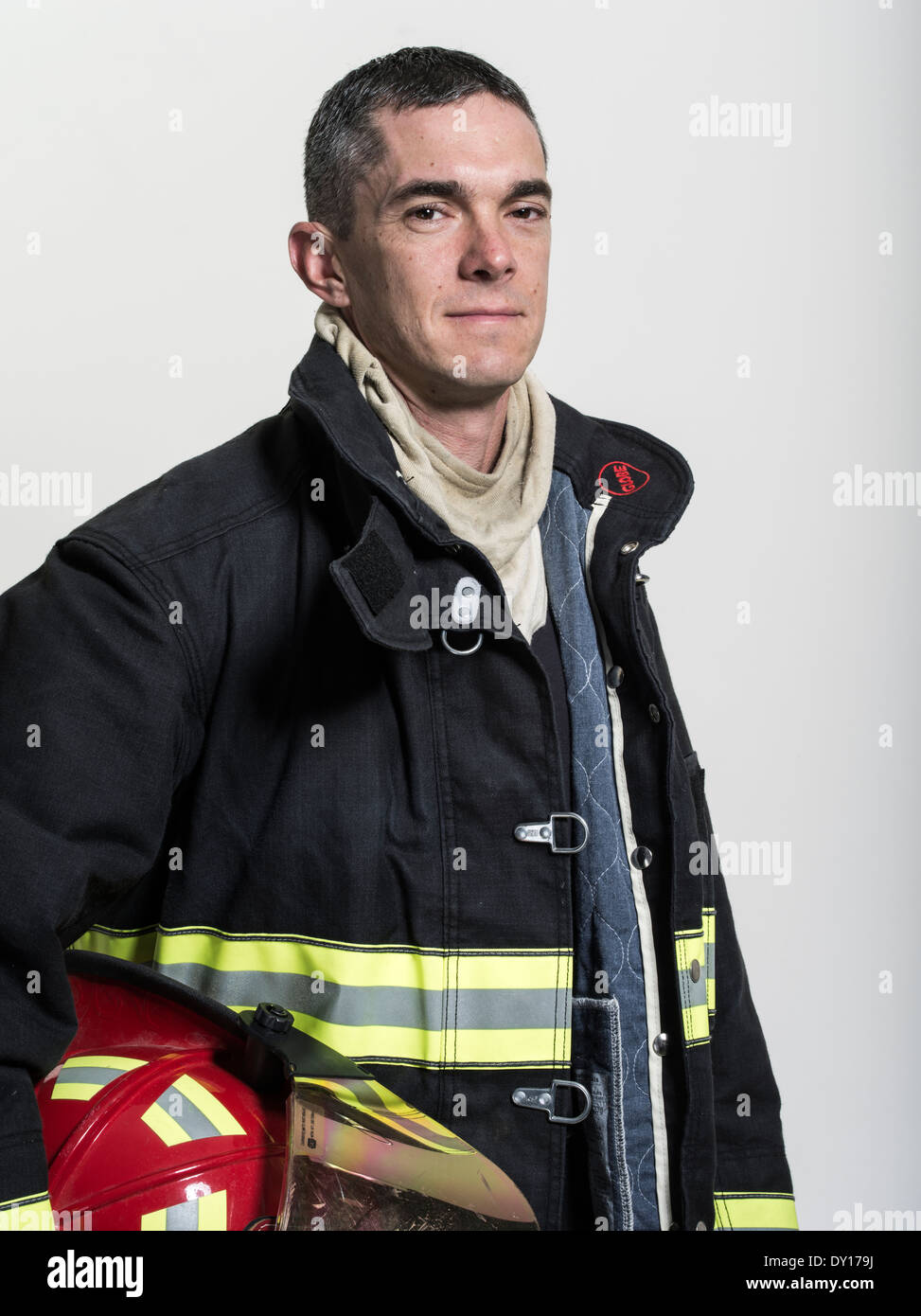 Male firefighter in structural firefighting uniform with breathing apparatus and axe Stock Photo