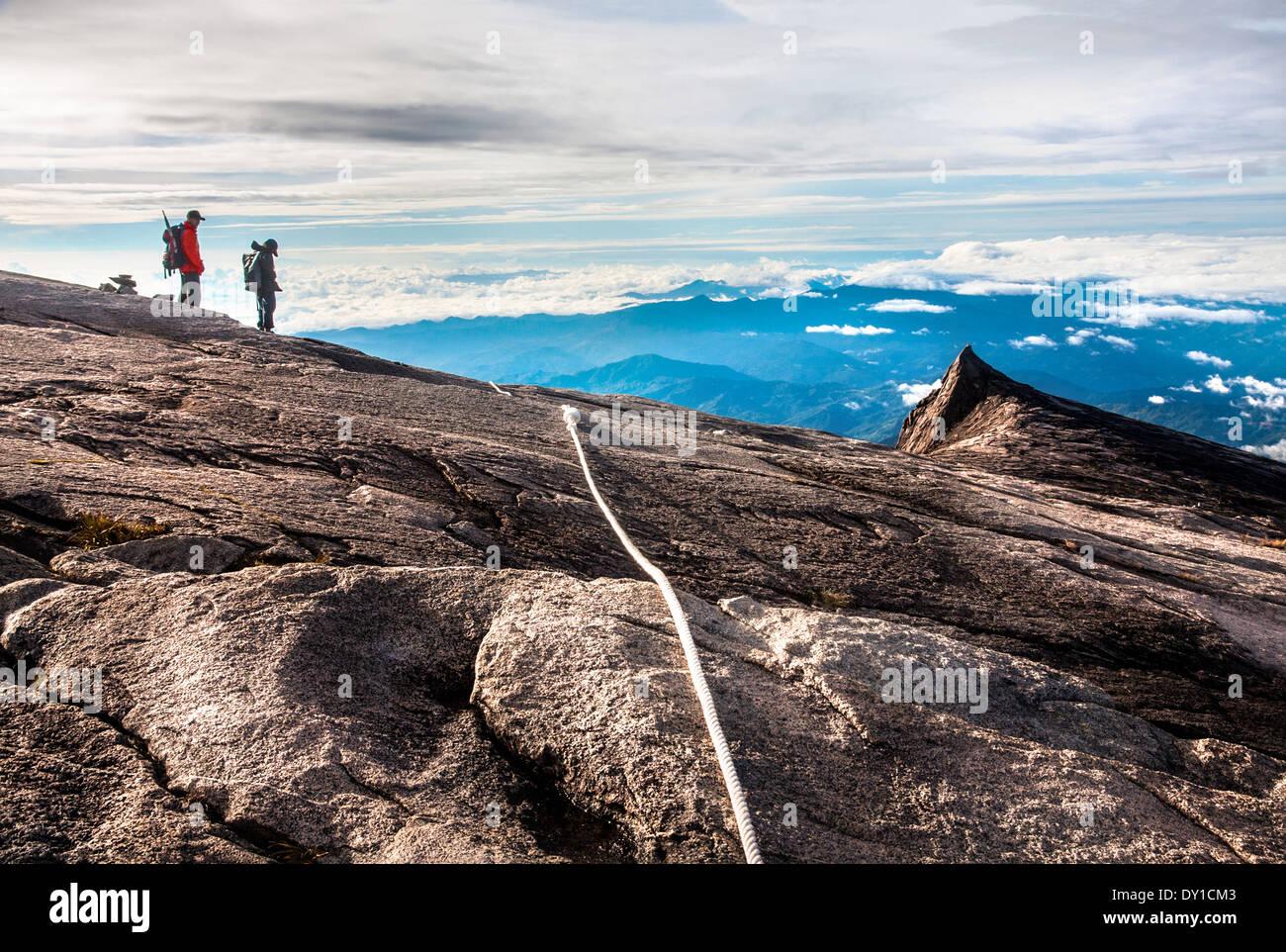 Tourists hike down Mount Kinabalu on February 16, 2012 in Kota Kinabalu,Malaysia - Stock Image