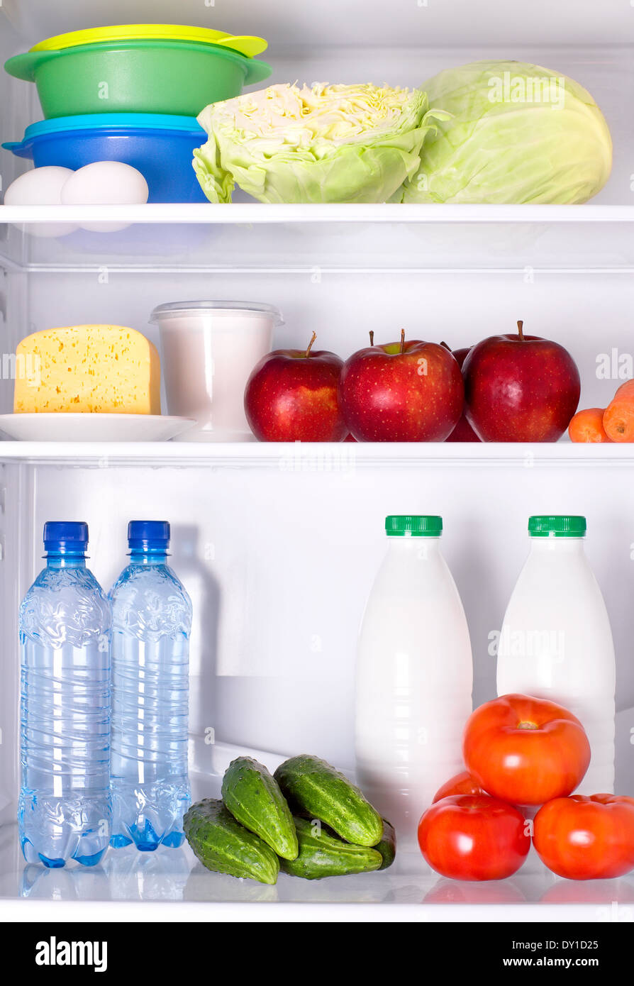 Refrigerator full of healthy food. Vegetables fruits water and dairy products  sc 1 st  Alamy & Refrigerator full of healthy food. Vegetables fruits water and ...