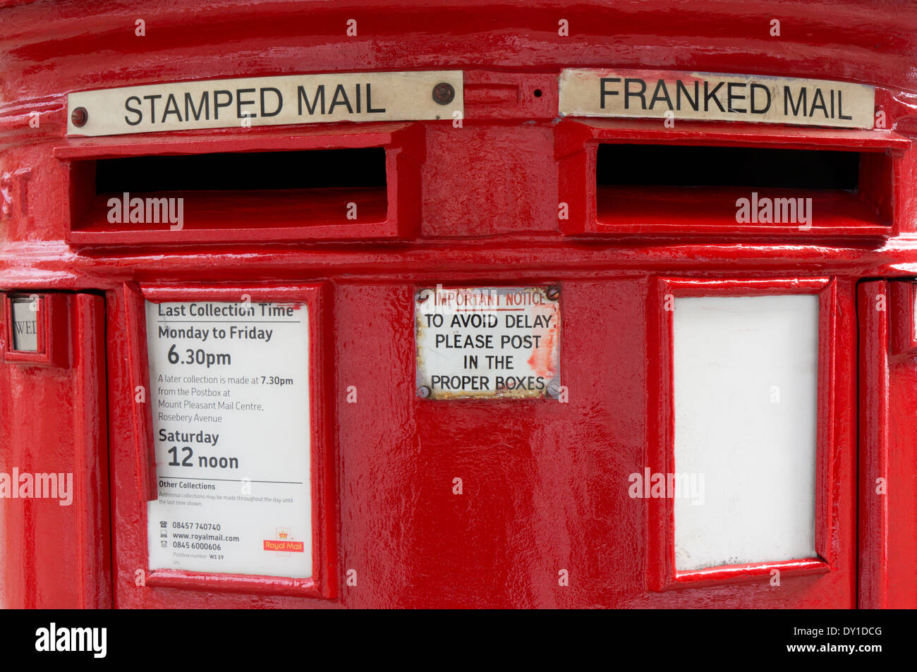 A pillar box with separate openings for stamped and franked mail. - Stock Image