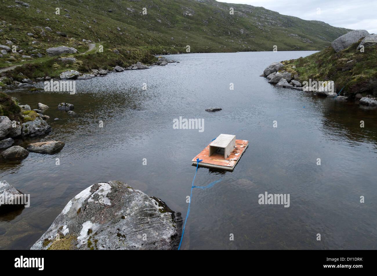 Mink Raft on Loch Aiseaphat, Gleann Chliostair in the North Harris hills, Western Isles, Scotland, UK. - Stock Image