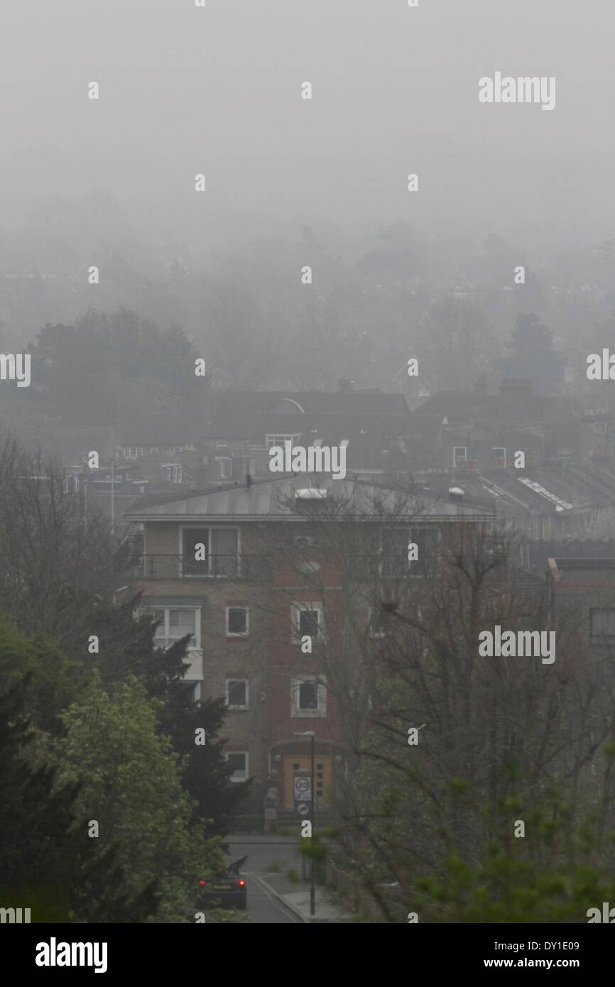 Wimbledon London, UK. 3rd April 2014. A general view of  hazy Southwest London in poor visibility brought about by of a mix of local and European emissions and dust from the Sahara as DEFRA Department for Environment Food and Rural Affairs warns high air pollution is set to continue across England Credit:  amer ghazzal/Alamy Live News - Stock Image