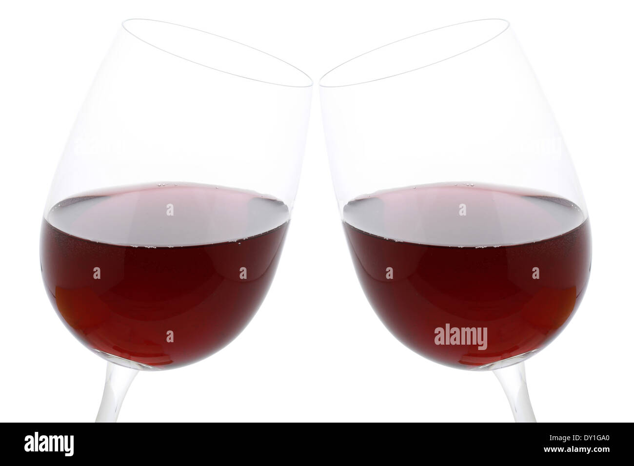 Clink glasses with red wine, isolated on a white background - Stock Image
