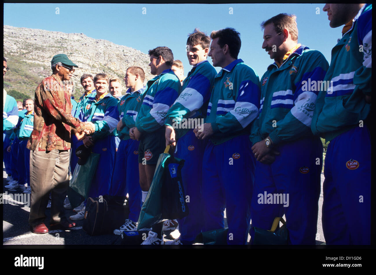 President Nelson Mandela meets the South African rugby team after a practice session at the Silvermine training Stock Photo