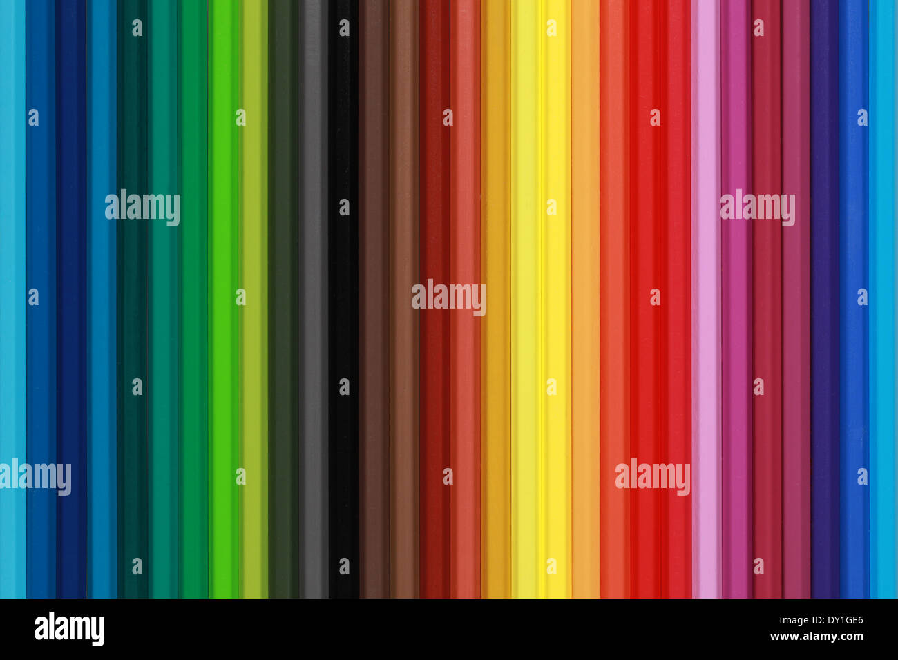 Collection of colored pencils forming a background - Stock Image