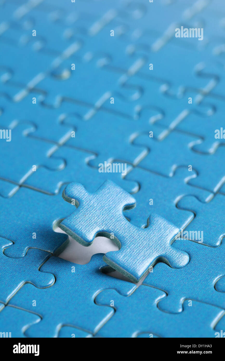 Putting the last piece of puzzle in place - Stock Image