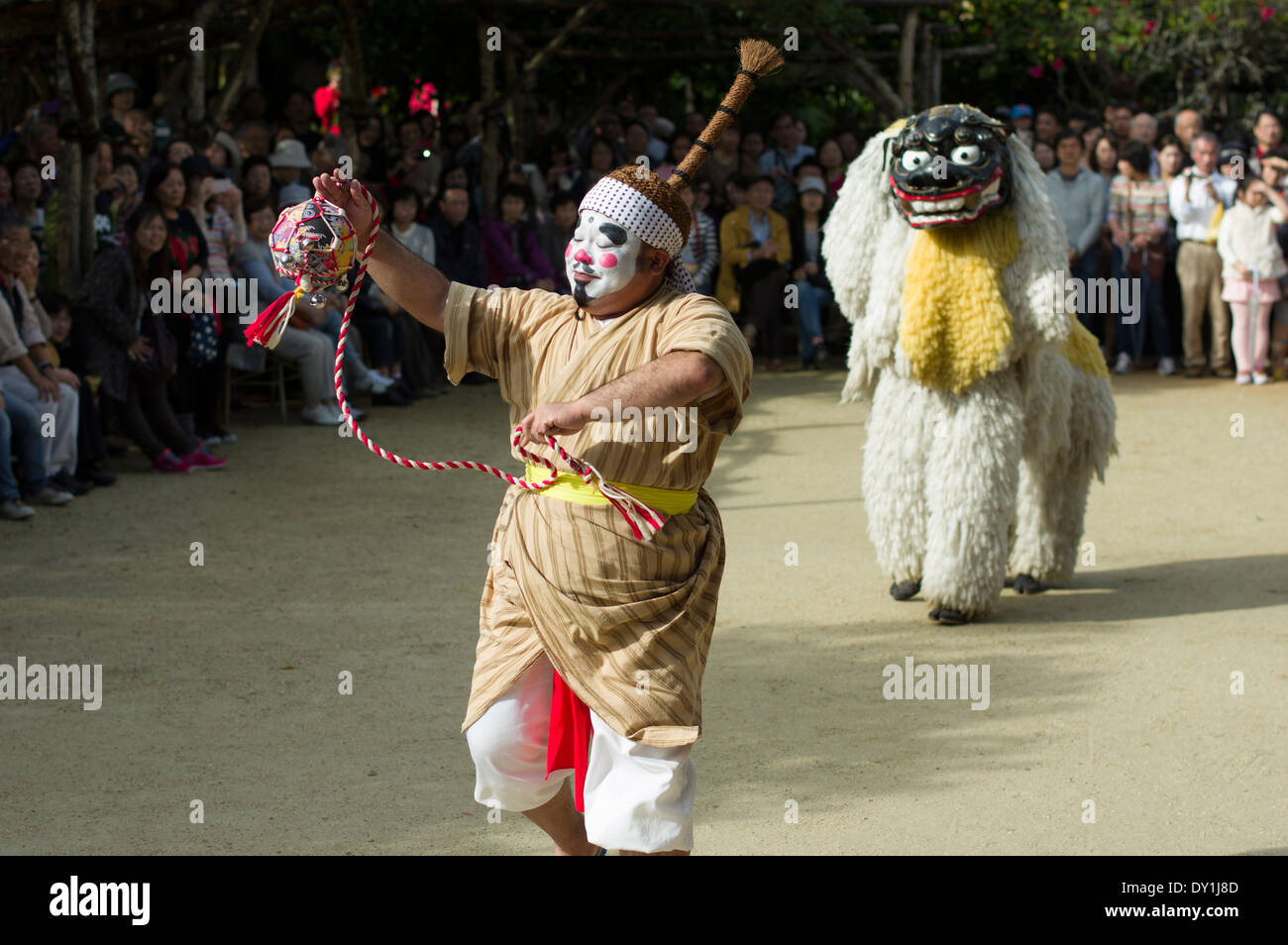 Chondara Clown and Shishimae lion dancers at Ryukyu Mura, Yomitan Village, Okinawa, Japan - Stock Image