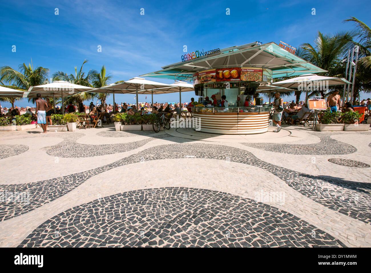 Rio de Janeiro, Copacabana, Avenida Atlantica, mosaic of Roberto Burle Marx, beach bar, people, Brasil - Stock Image