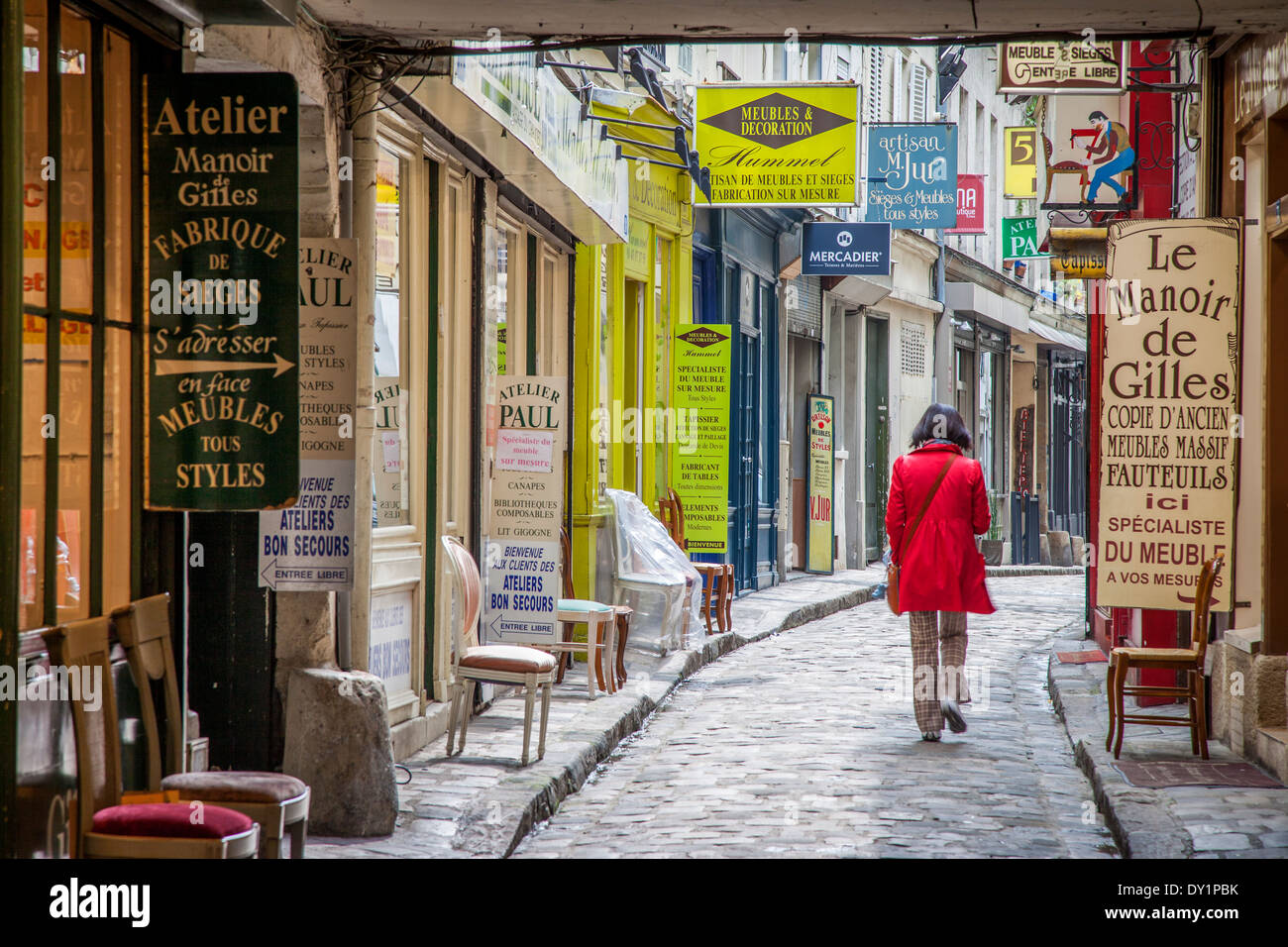 woman in red coat walking down passage du chantier near faubourg stock photo 68266343 alamy. Black Bedroom Furniture Sets. Home Design Ideas