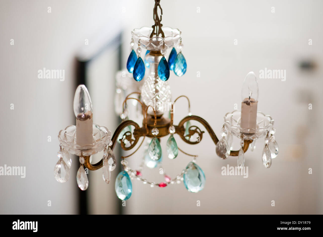 Detail of chandelier with assorted blue glass drops - Stock Image