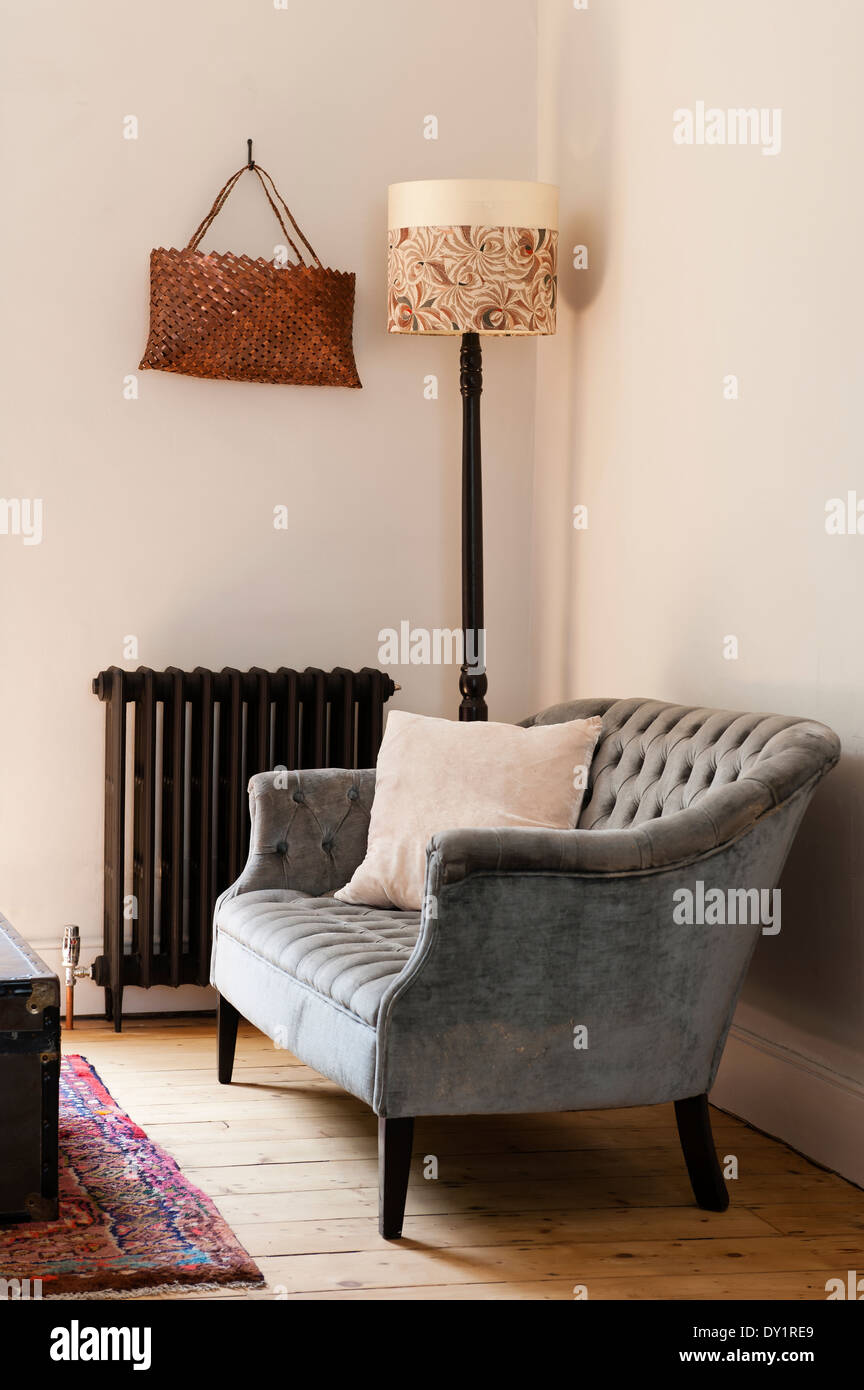Grey Buttoned Sofa By Old Fashioned Radiator And Floor Lamp With Stock Photo Alamy