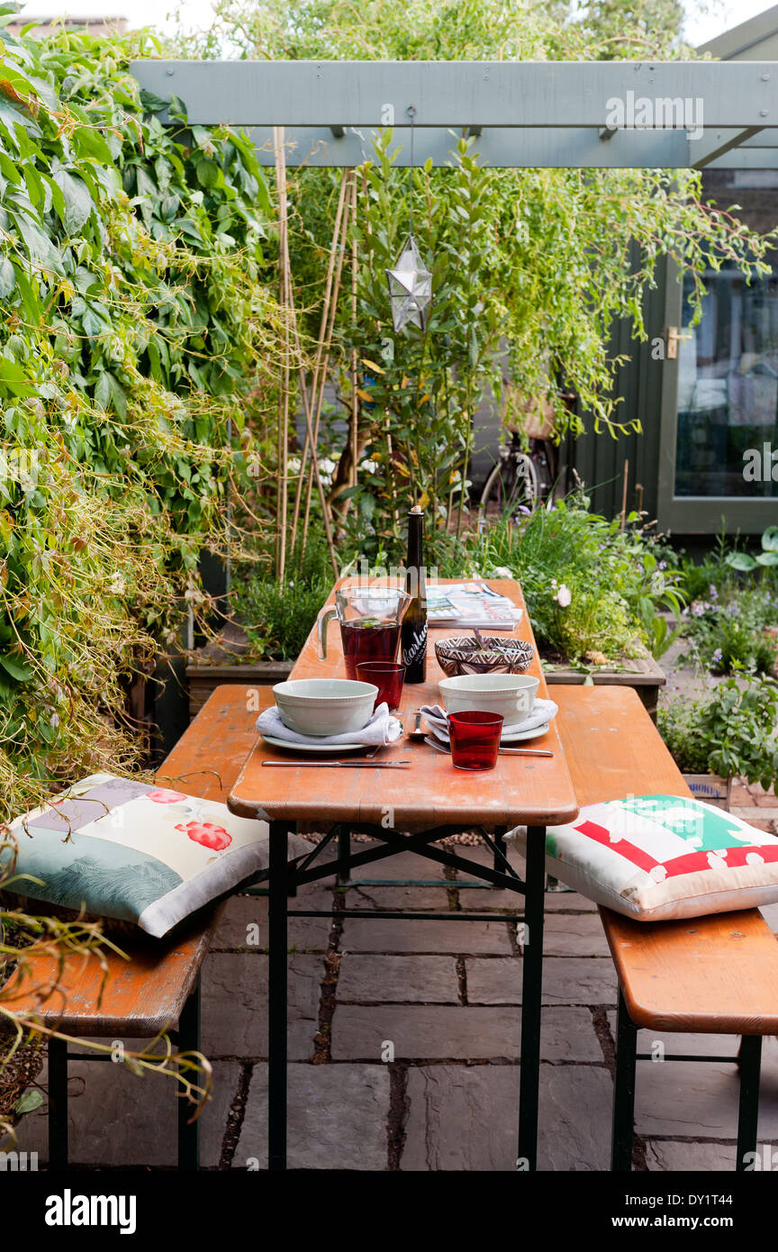 Astonishing Wooden Bench And Table On Paved Garden Patio Underneath Forskolin Free Trial Chair Design Images Forskolin Free Trialorg