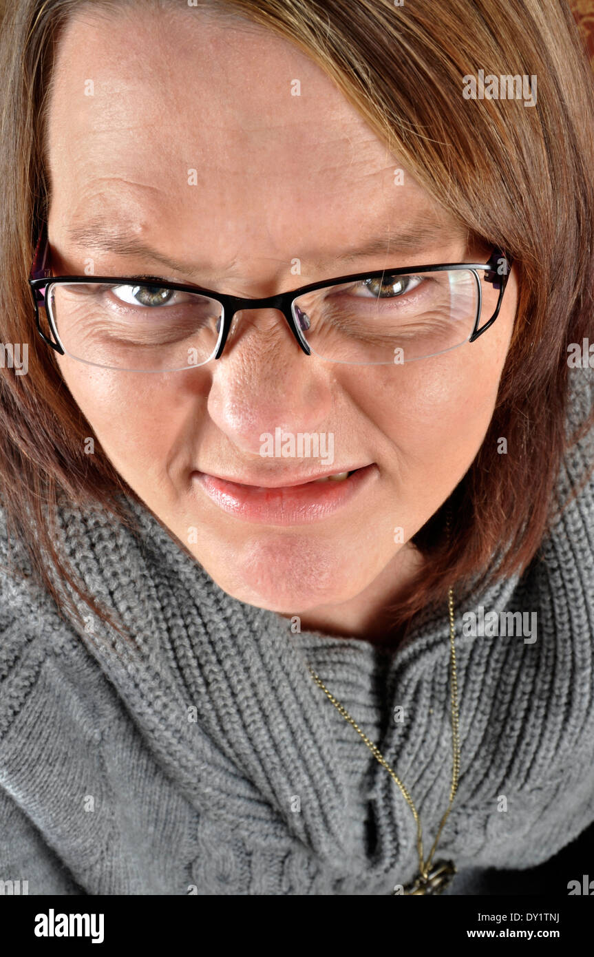 Woman smiling grimacing - Stock Image