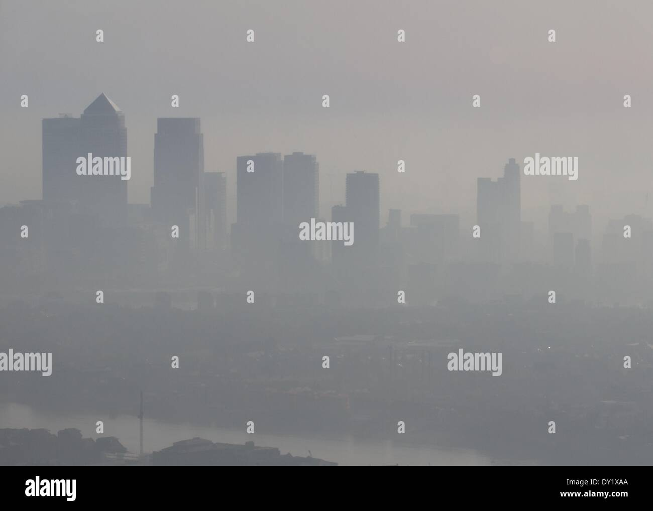 Record pollution levels over Canary Wharf in London, England Credit:  Paul McCabe/Alamy Live News - Stock Image