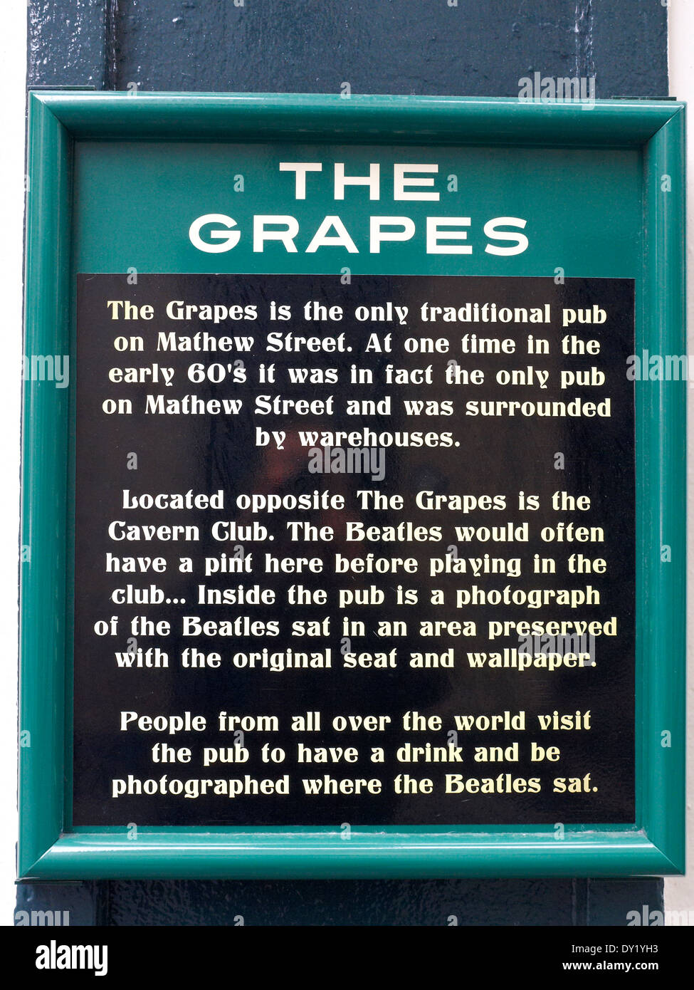 Plaque on outside wall of The Grapes pub on Mathew Street, explaining his history in Liverpool UK - Stock Image