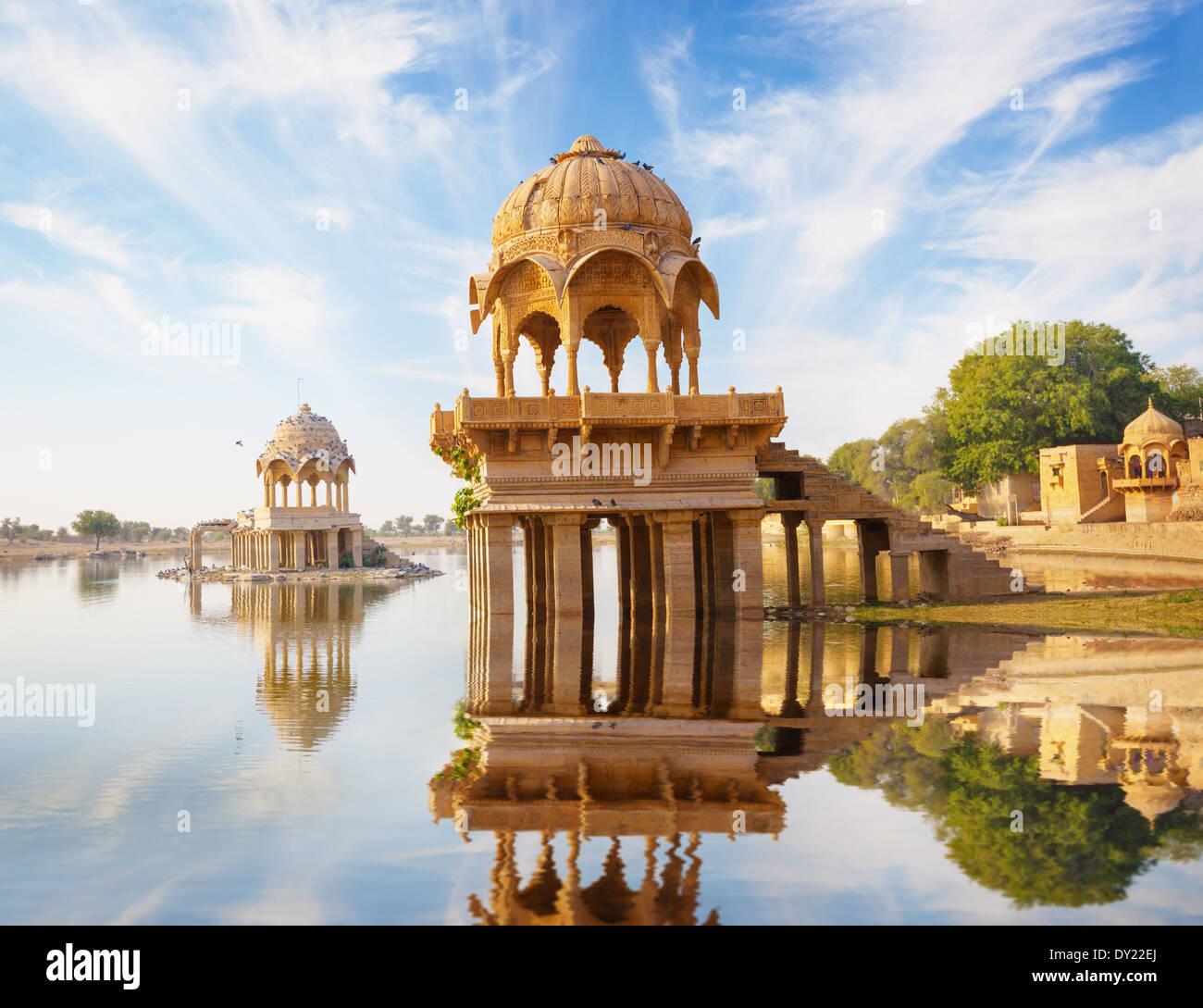 Indian landmarks - Gadi Sagar temple on Gadisar lake - Jaisalmer, Rajasthan, north India Stock Photo