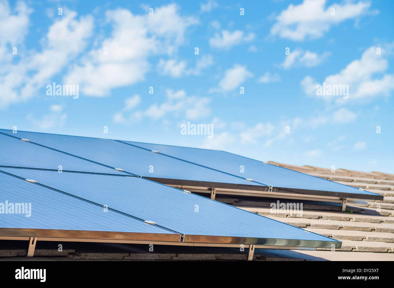 new solar panels on the roof of modern suburban house - Stock Image