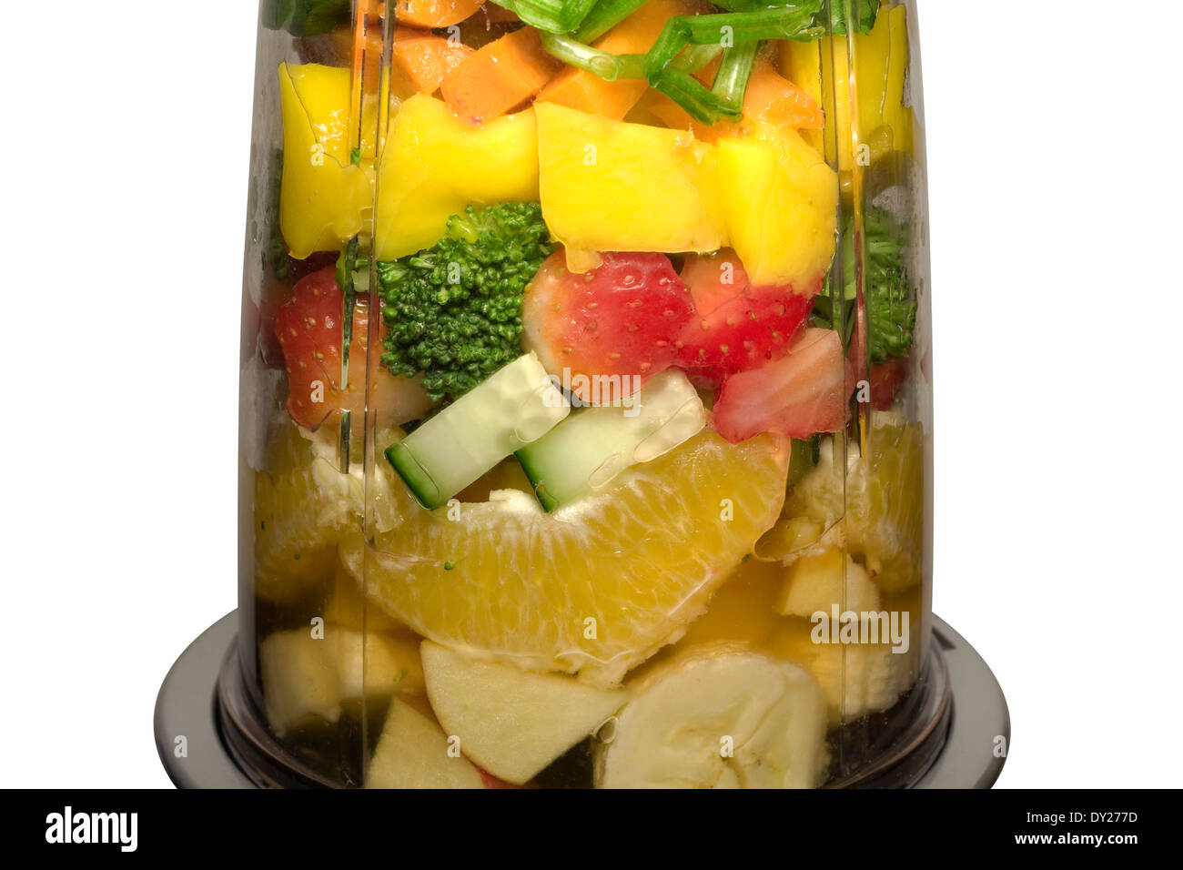 Cut Out. Various Fruits and Vegetables inside of a smoothie machine waiting to be pulverized (f/11) - Stock Image