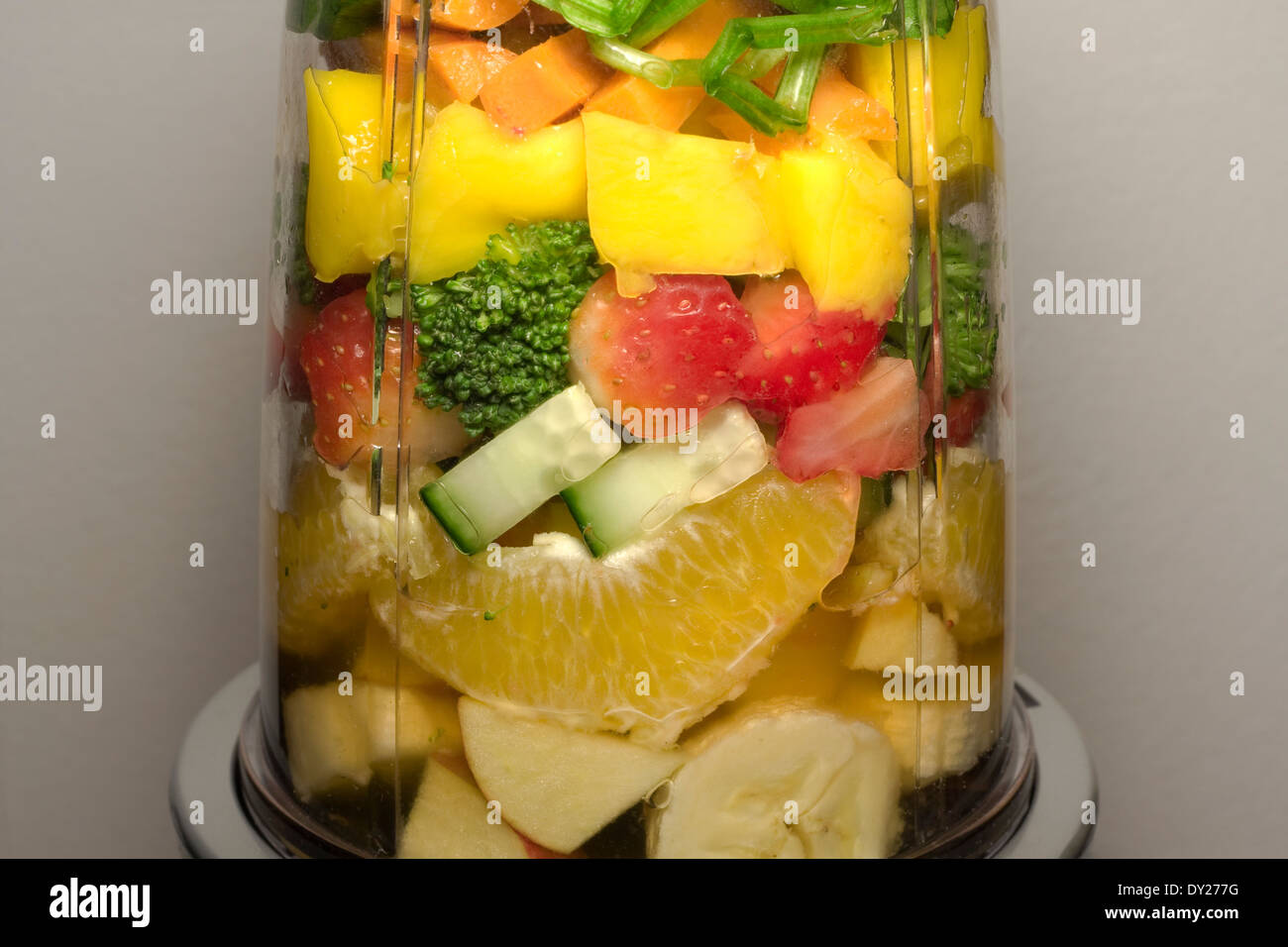 Various Fruits and Vegetables inside of a smoothie machine waiting to be pulverized (f/11) - Stock Image