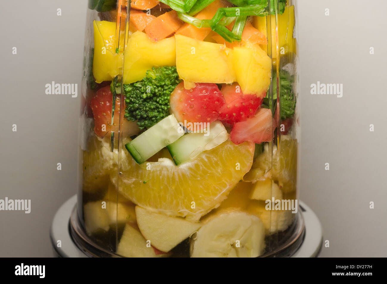 Various Fruits and Vegetables inside of a smoothie machine waiting to be pulverized  (f/8) - Stock Image