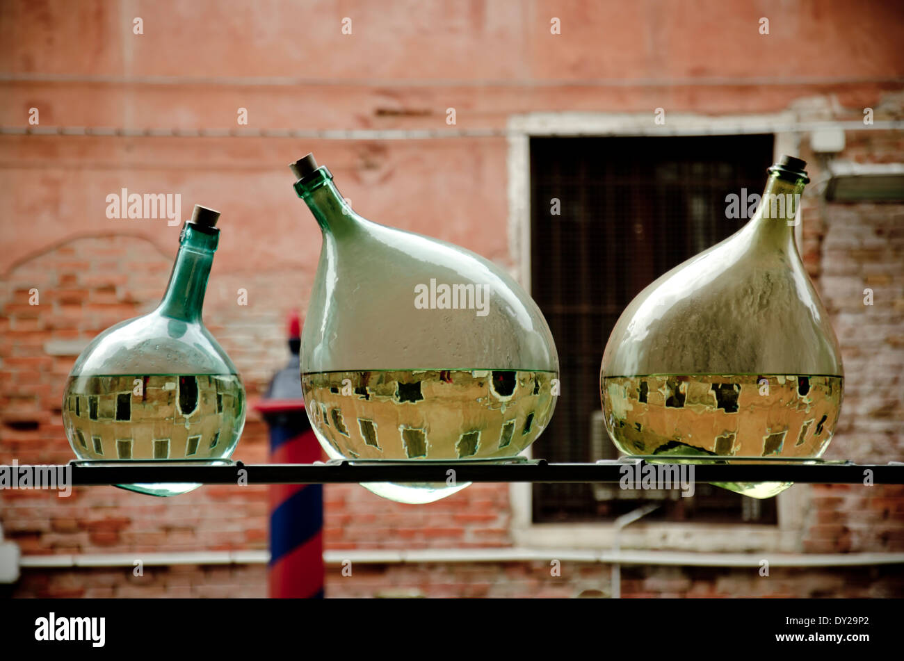 artwork in Venice during Biennale 2013 consisting of three half empty bottles - Stock Image