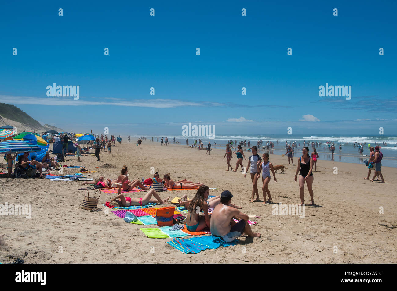 Holidaymakers walking on the beach of Morgan Bay, Eastern Cape, South Africa - Stock Image