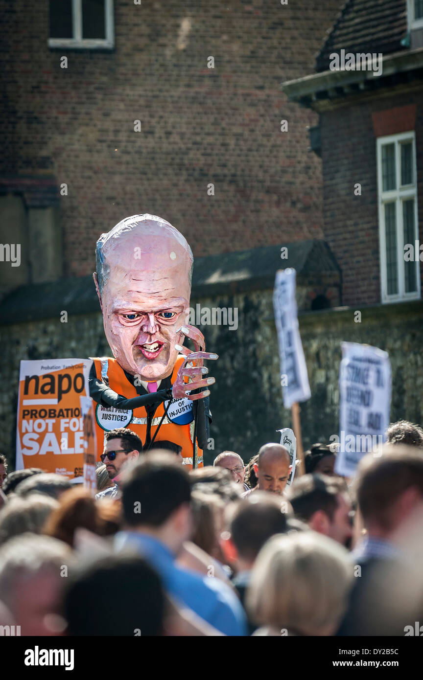 A large effigy of Chris Grayling in a demonstration against privatisation of the probation service. - Stock Image