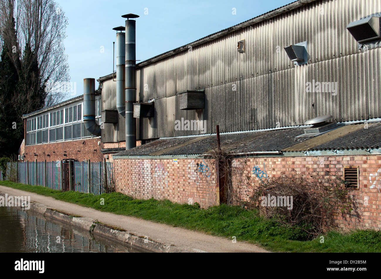 Factories alongside the Grand Union Canal, Warwick, UK - Stock Image