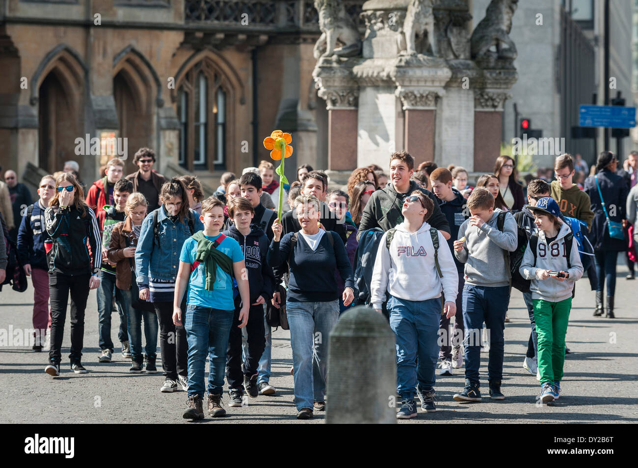 A group of young tourists and their guide in London. - Stock Image