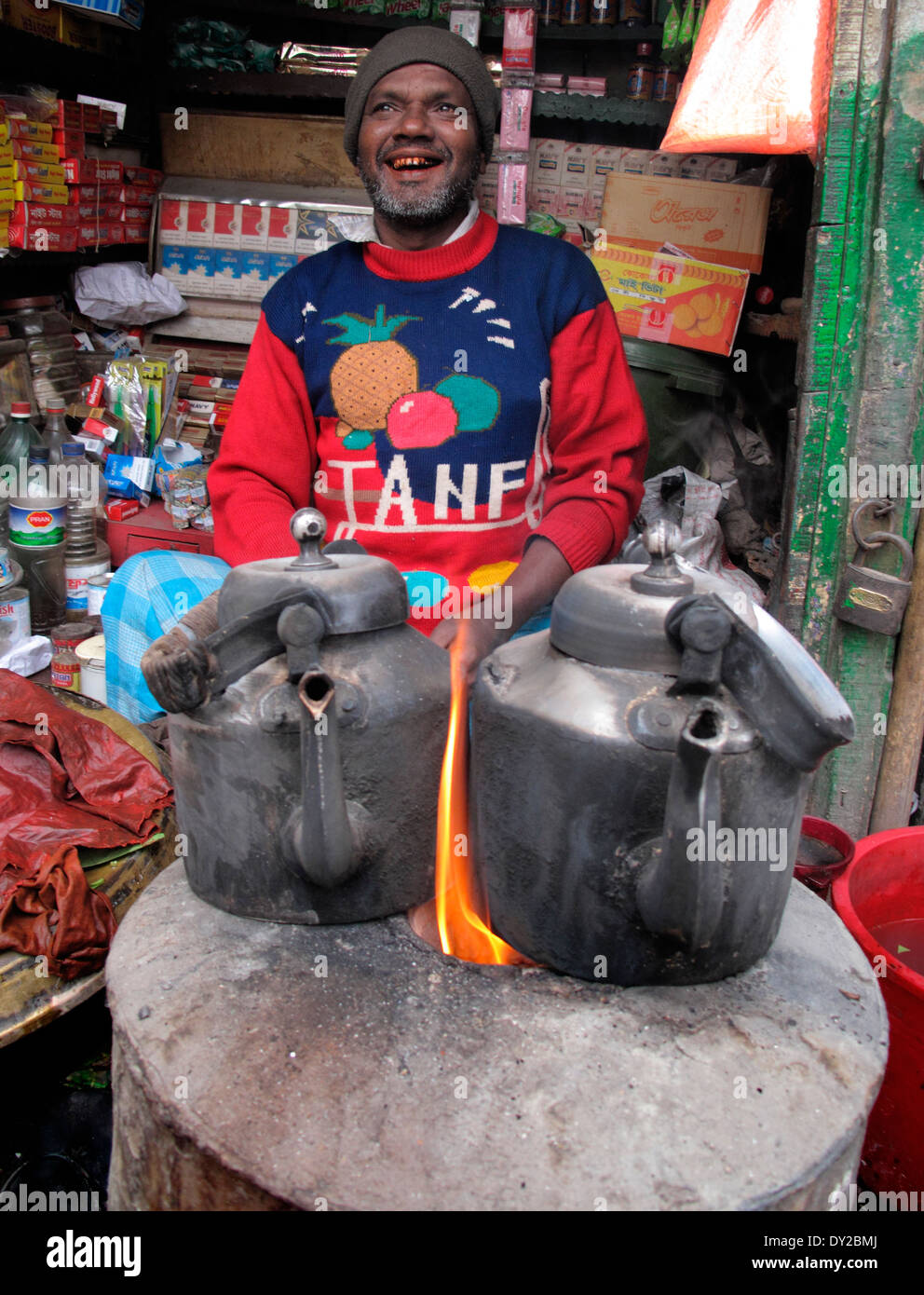 Cooking water for tea on fire - Stock Image