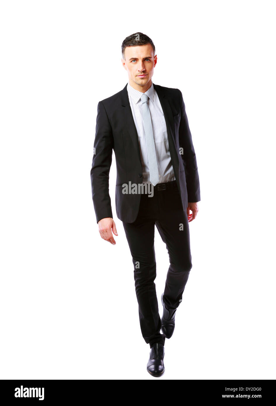 Portrait of a businessman walking isolated on a white background - Stock Image