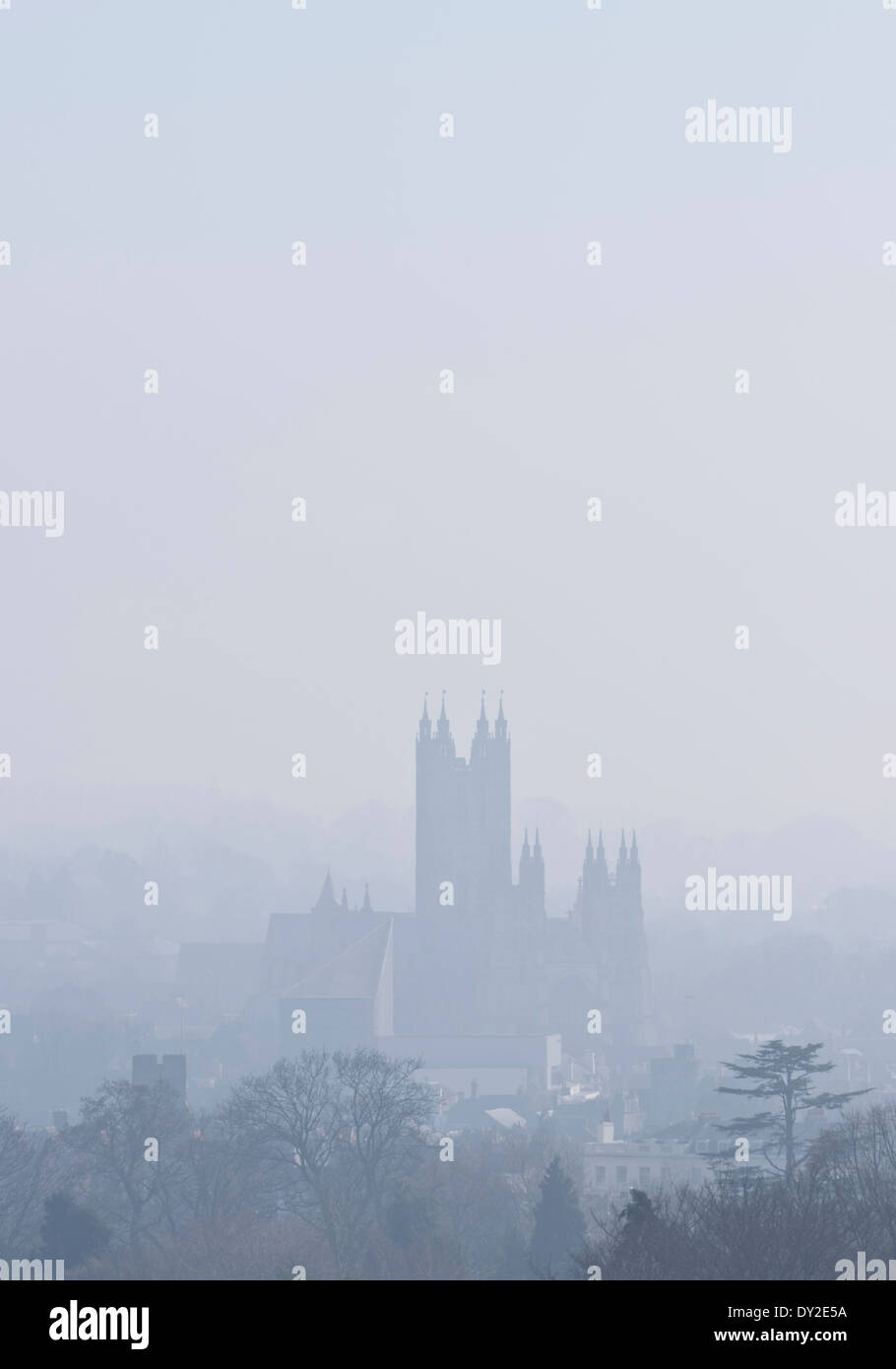 The silhouette of Canterbury Cathedral after a morning of thick fog is slowly being burnt away. Stock Photo