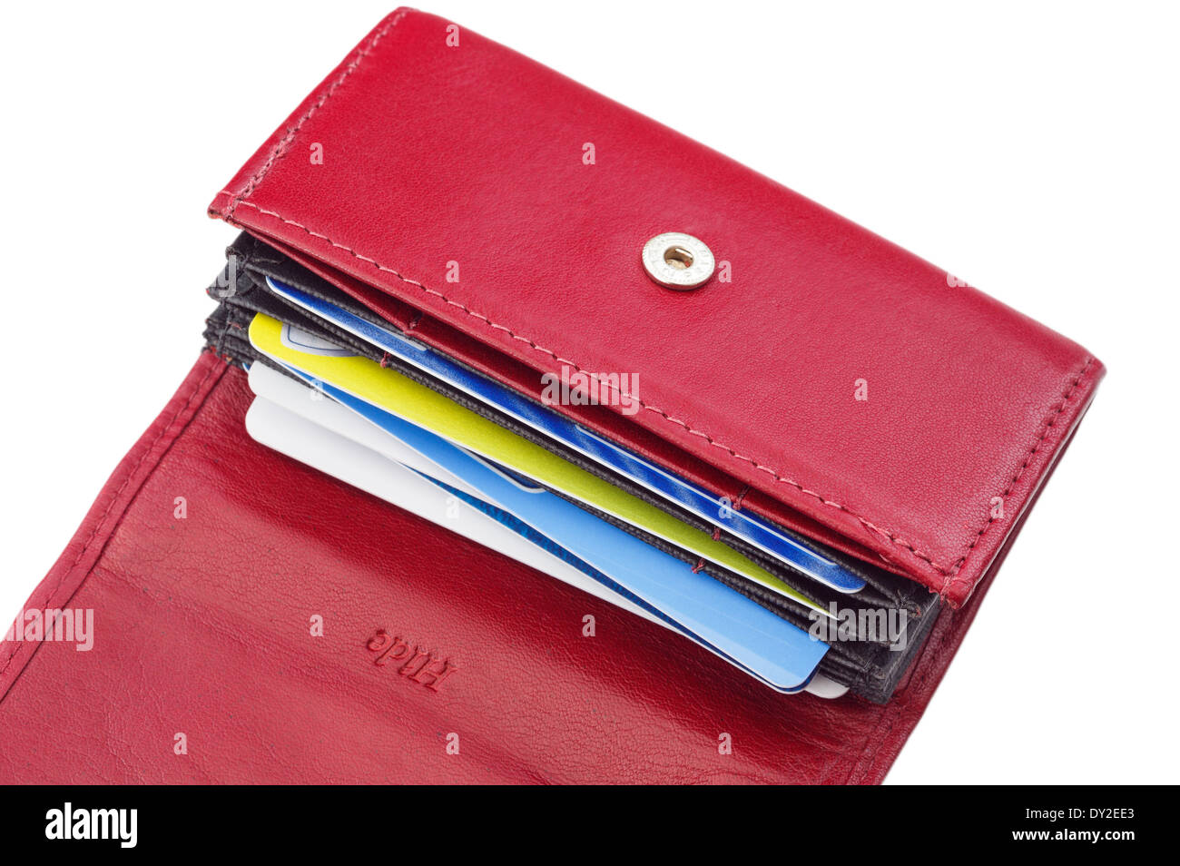 An open red leather wallet credit card holder containing bank cards on a white background. England UK Britain - Stock Image