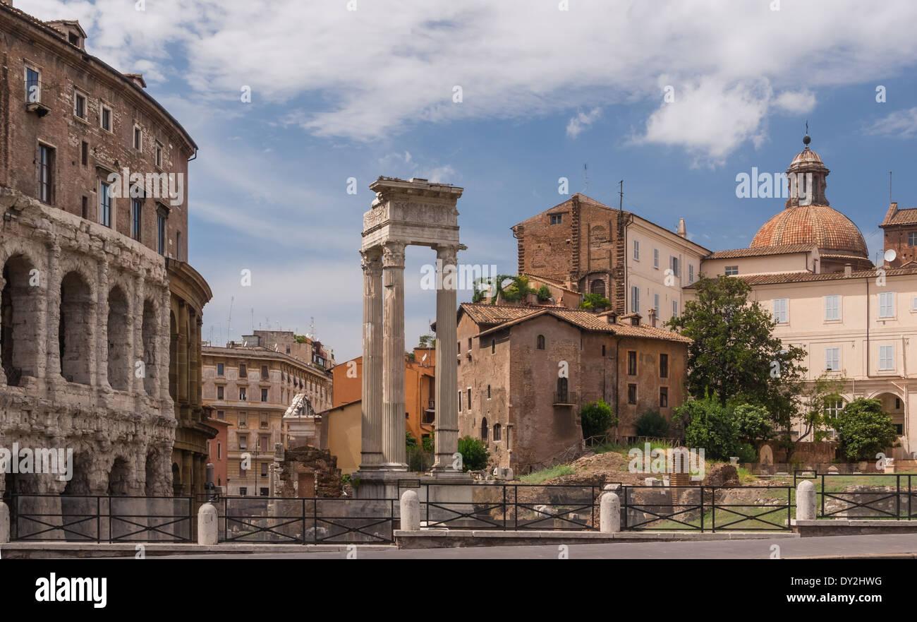 Temple of Apollo Sosianus, partial view of theater of Marcellus at left. Dome of the church Santa Maria in Campitelli. Rome, Ita - Stock Image