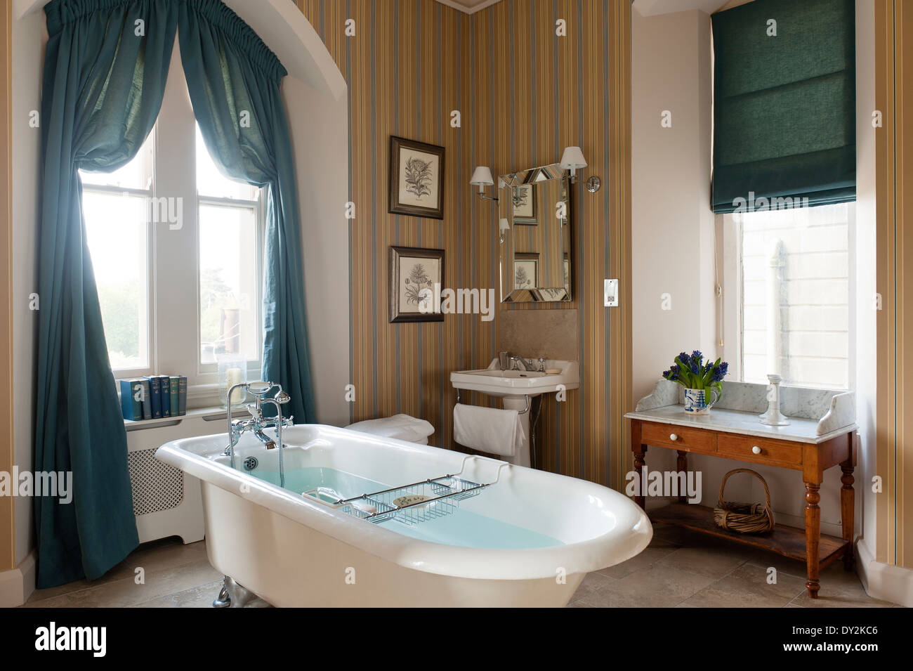 Free Standing Roll Top Bath In Bathroom With Striped Wallpaper And Teal  Curtains And Blind
