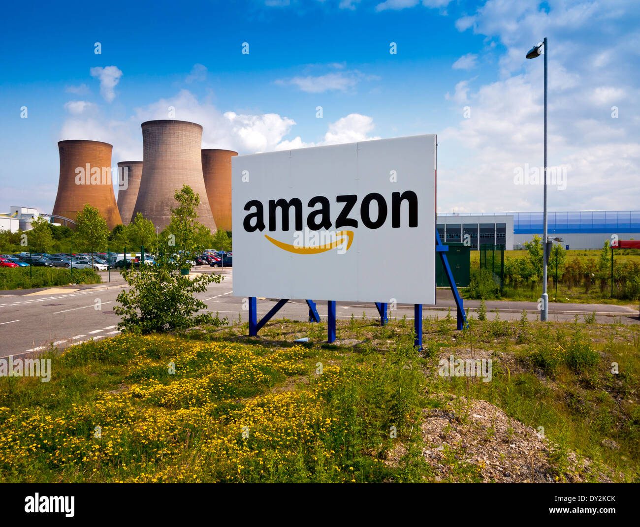 Sign outside the entrance to  Amazon UK warehouse in Rugeley Staffordshire next to cooling towers of coal fired Stock Photo