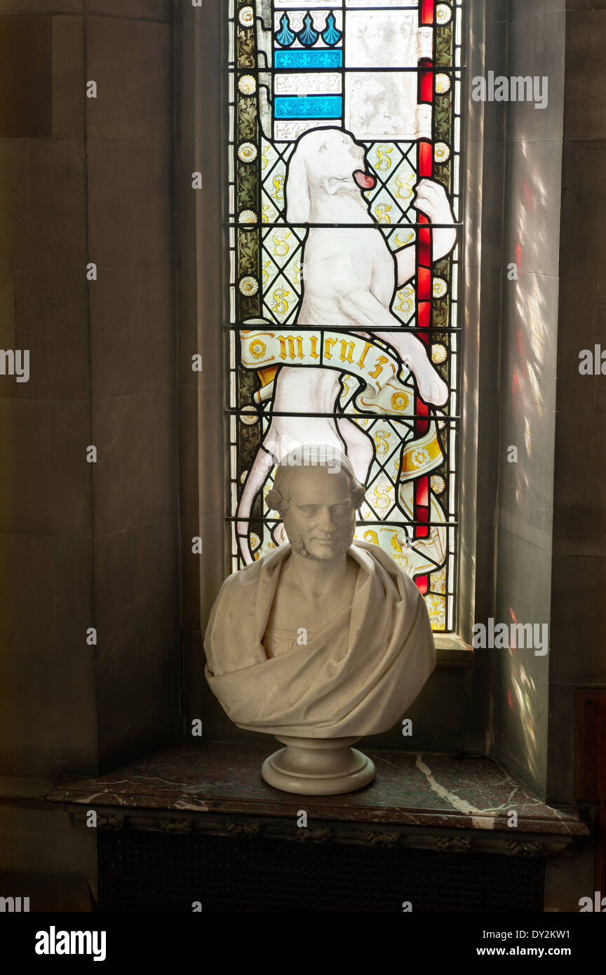 Stone bust on marble sill of stained glass window Stock Photo