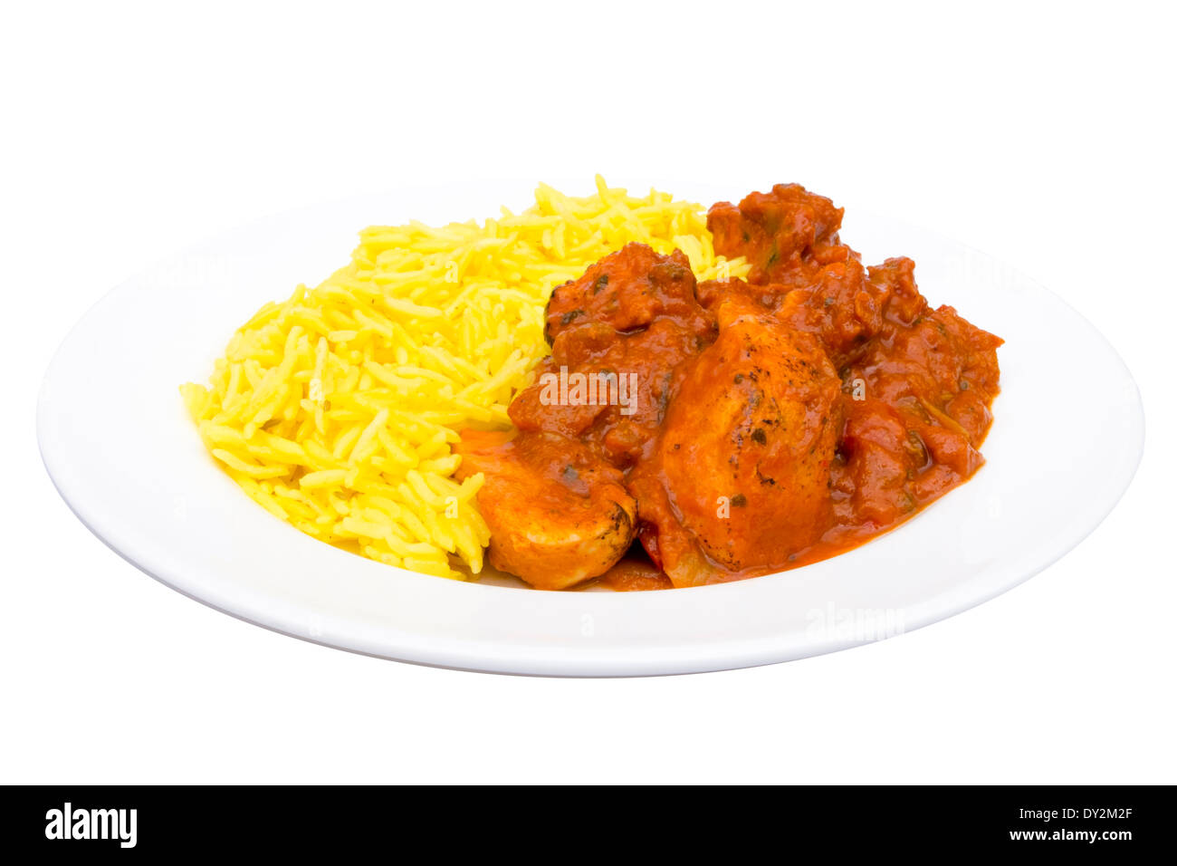 Chicken Jalfrezi and Pilau Rice dish cut out against a white background. - Stock Image
