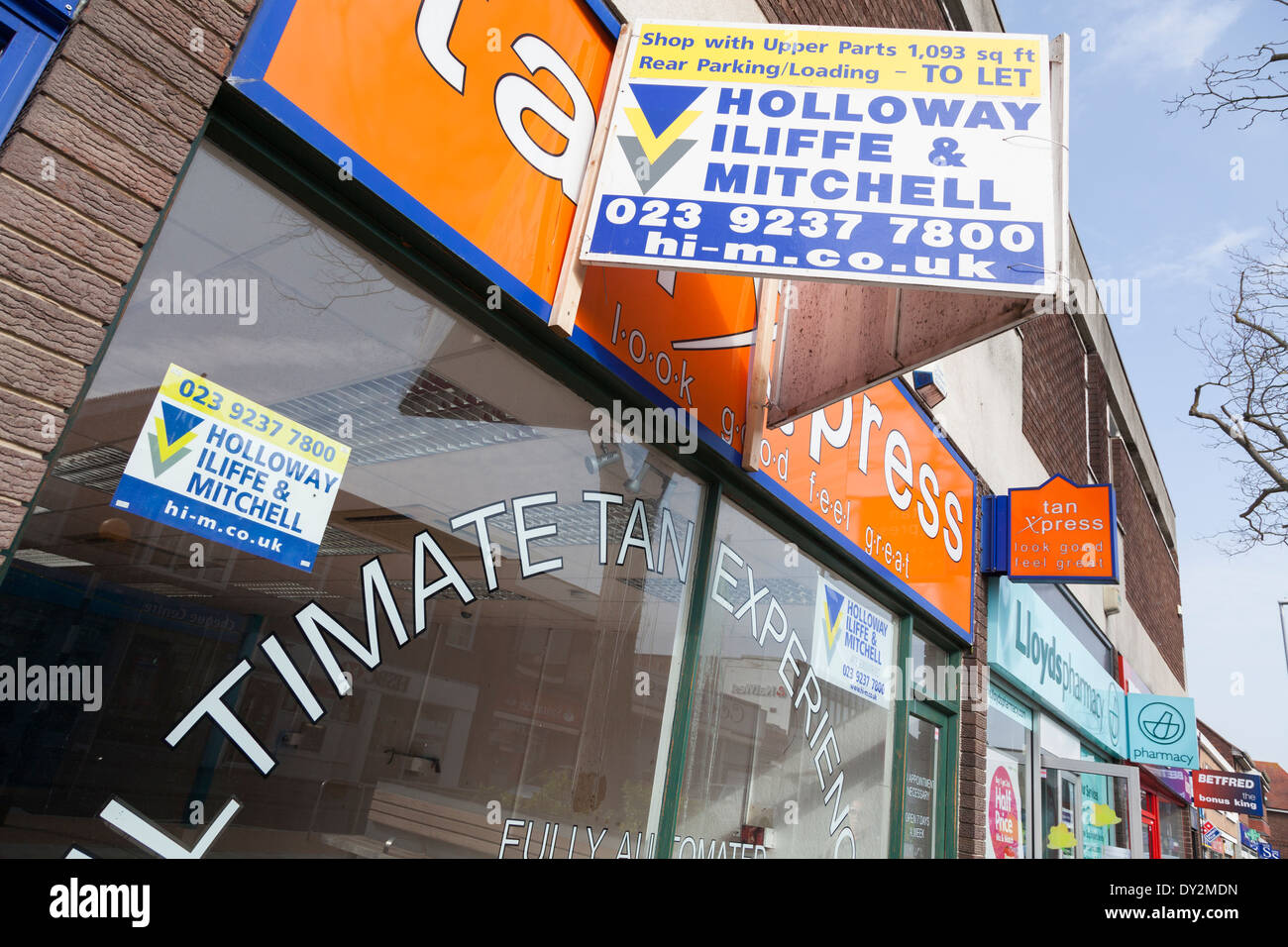 Tanning shop closed down with premises to let sign. Stock Photo