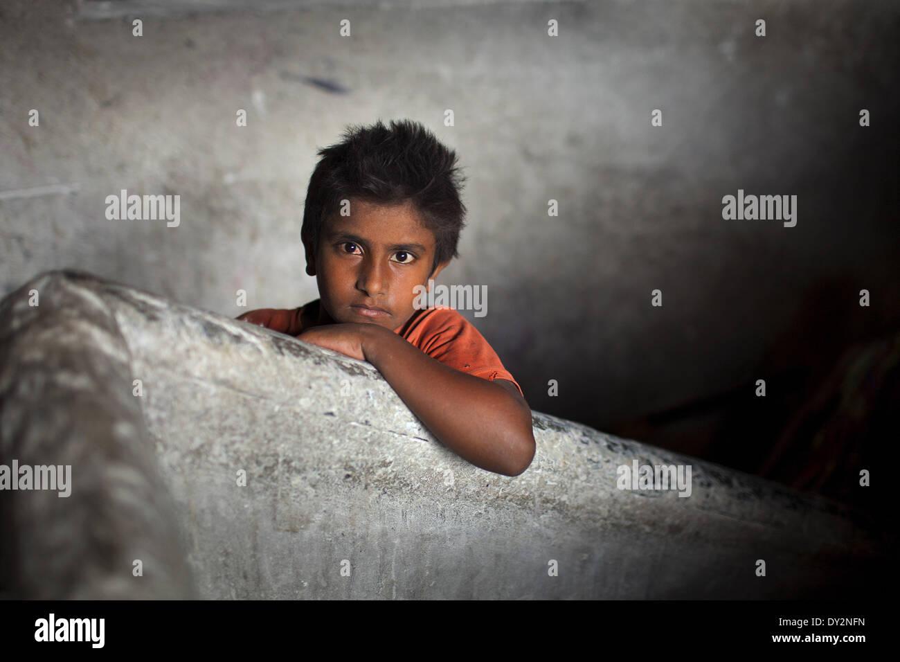 Dhaka, Bangladesh. 4th Apr, 2014. SHOHAG works at a manual soap factory in Dhaka, Bangladesh. Child labour is not - Stock Image