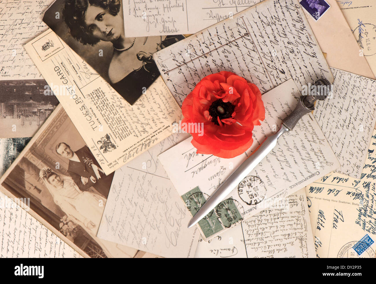 old photos and post cards with letter opener. vintage grunge background - Stock Image