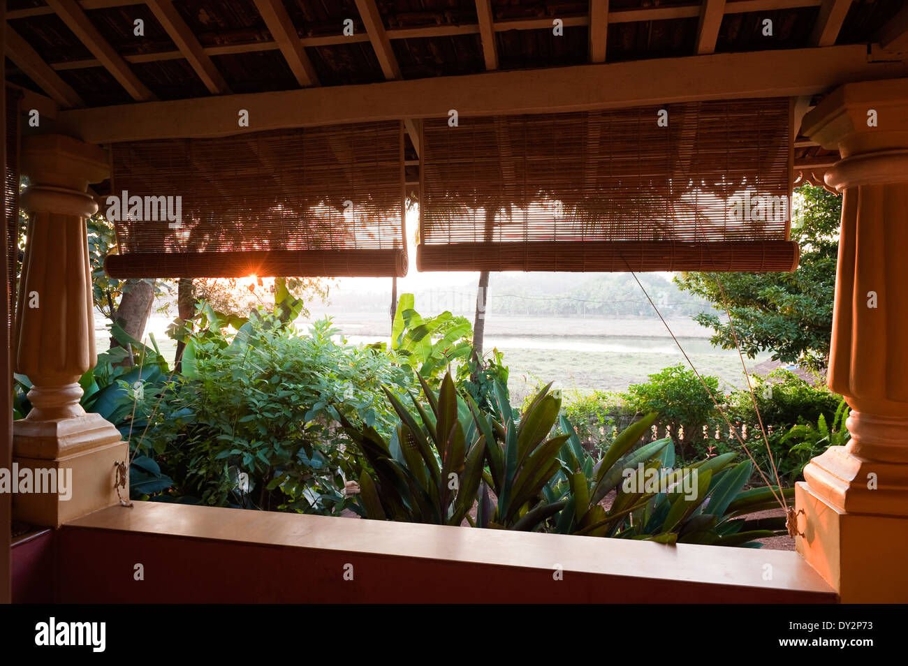 Bamboo blinds on veranda of Goan home - Stock Image
