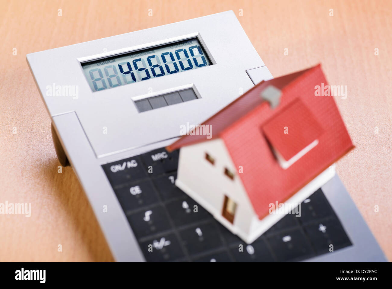 House stands on the keyboard of a calculator. March 2014 Stock Photo