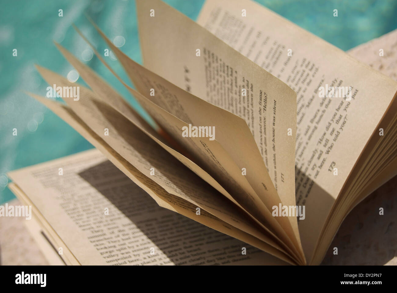 Reading Paperback Book Pages - Stock Image