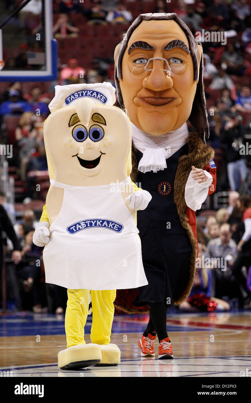 April 2, 2014: The Tastykake mascot in action with the Ben Franklin mascot during the NBA game between the Charlotte Bobcats and the Philadelphia 76ers at the Wells Fargo Center in Philadelphia, Pennsylvania. The Bobcats won 123-93. Christopher Szagola/Cal Sport Media - Stock Image