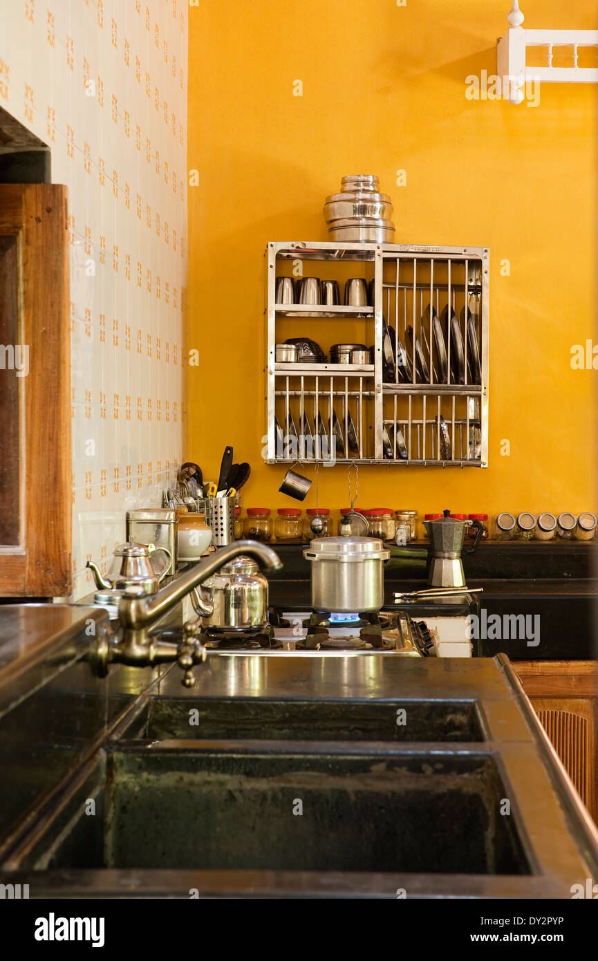 Goan kitchen detail with metallic plate rack and double sink - Stock Image
