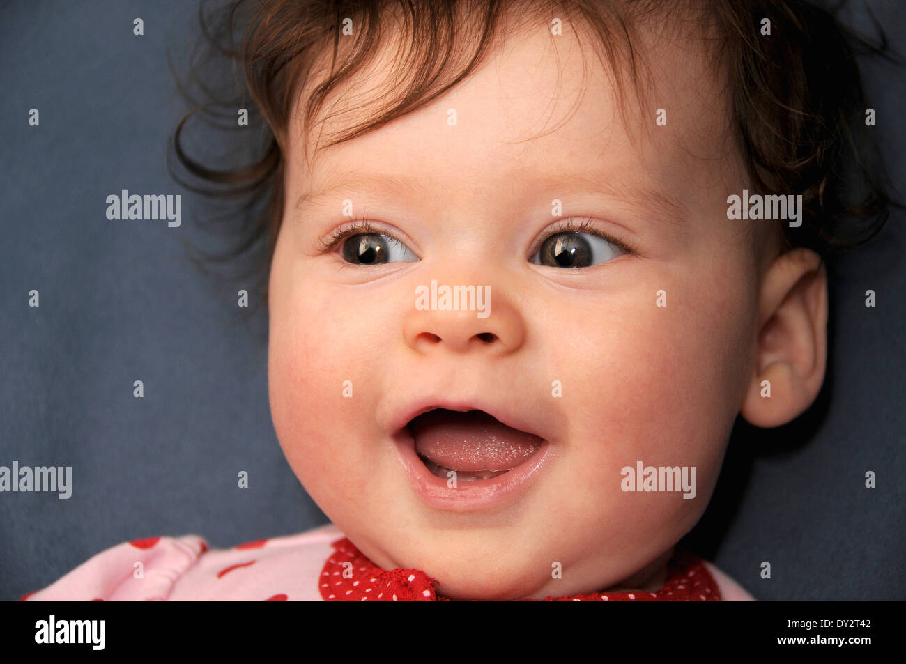 An infant with her parents. Stock Photo