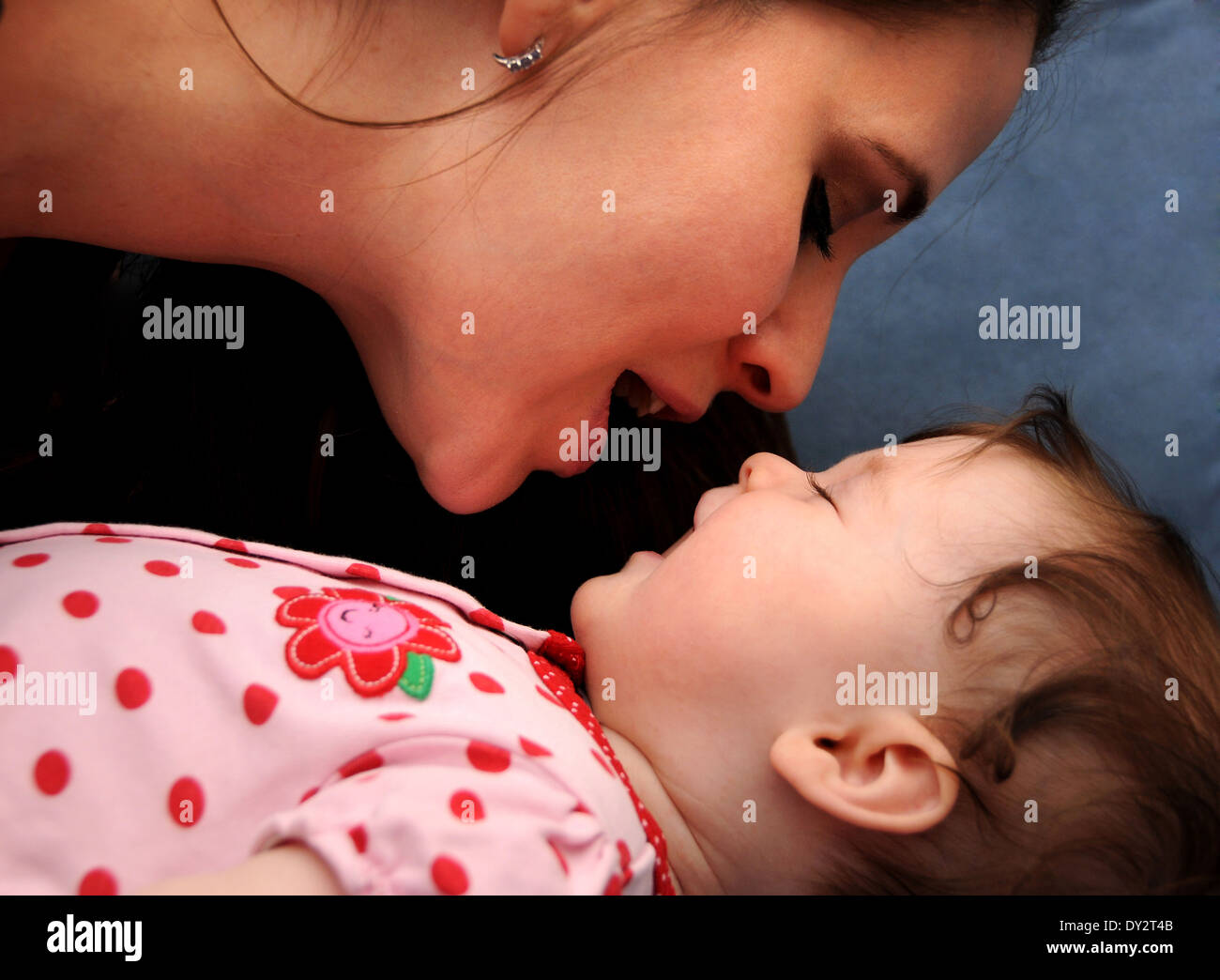An infant with her mother. Stock Photo
